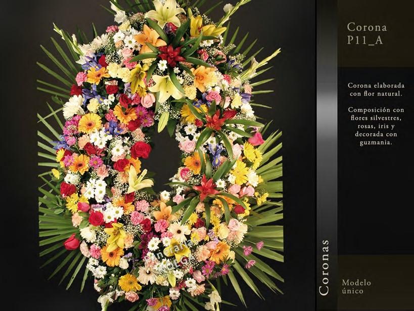 Corona de rosas iris y guzmania funerarias noega for Jardin noega tanatorio gijon esquelas